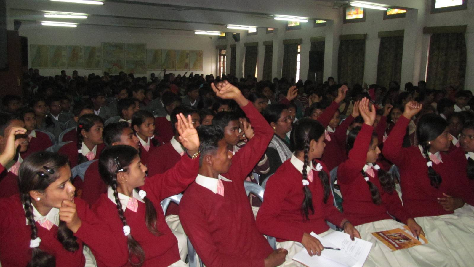 slum snd village Young boys and girls attending  seminar in stop Discrimination  topic