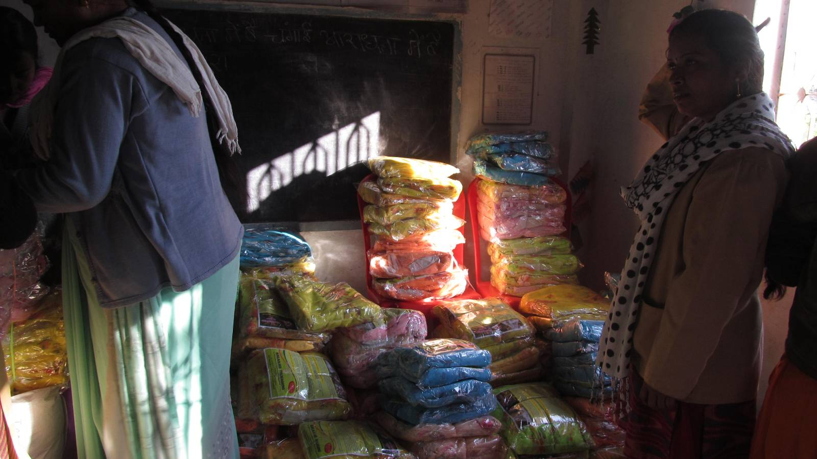 Mosquito net distribution to street and labor families