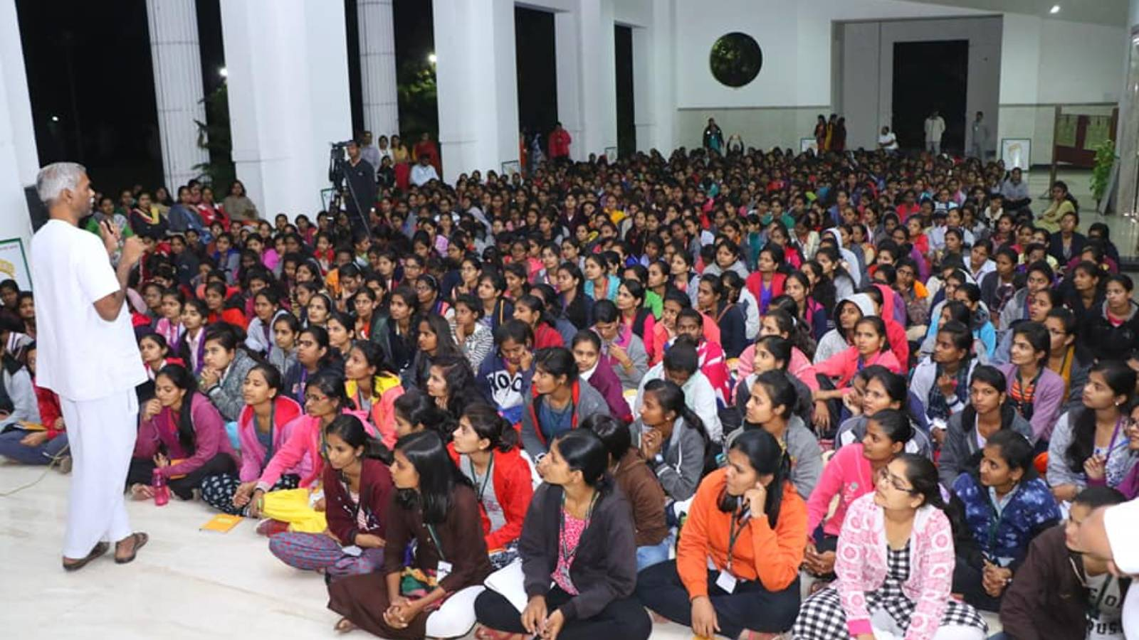 Dr. Avinash Saoji inteacting with college youth girls